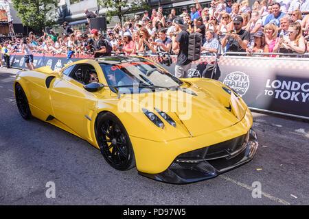 Covent Garden, London, UK.  05/08/2018.  Yellow Pagani Huayra Roadsterleaves at the start of the 2018 Gumballl 3000 rally. - Stock Photo
