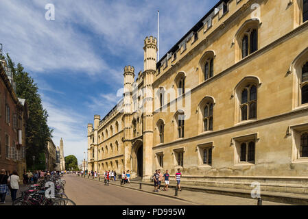 Exterior of Corpus Christi College from Trumpington Street with people walking on pavement outside, Cambridge, UK - Stock Photo