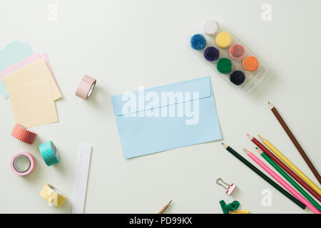 Colored pencils, paper clips and note pad, School supplies, Back to school, School and office supplies - Stock Photo