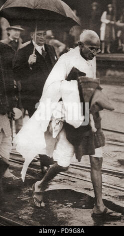 Mohandas Karamchand Gandhi, aka Mahatma Gandhi,1869 – 1948. Indian activist, leader of the Indian independence movement against British rule.  Seen here in London, England in 1930.  From These Tremendous Years, published 1938.