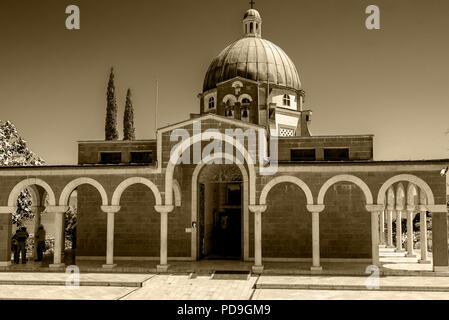 Church of the Beatitudes, Israel showing the facade and dome, the site where Jesus gave the Sermon on the Mount. Sepiamonochrome - Stock Photo
