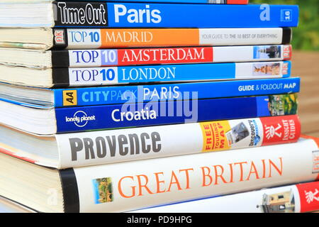 Stack of European travel guide books - Stock Photo
