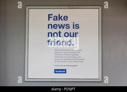LONDON, UK - AUGUST 7th 2018: Facebook fake news advert. Facebook announcement to reduce fake news stories on the social media website - Stock Photo