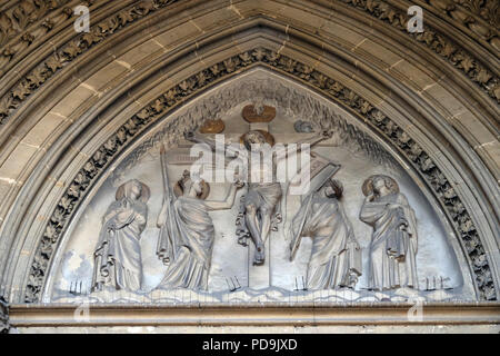Crucifixion bass relief on the portal of the Basilica of Saint Clotilde in Paris, France - Stock Photo