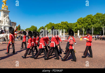 London England August 05, 2018 A detachment of the Grenadier Guards arrives at Buckingham Palace during the changing the guard ceremony - Stock Photo