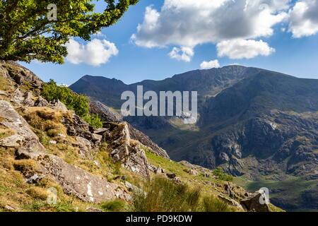 Garnedd Ugain and Crib Goch, part of the Snowdon massif viewed from Cwm Padrig, part of the Glyderau range; Snowdonia - Stock Photo