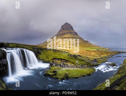 Stormy weather over Mount Kirkjufell with Kirkjufellsfoss Waterfall, Grundarfjordur, Snaefellsnes Peninsula, Vesturland, Iceland - Stock Photo