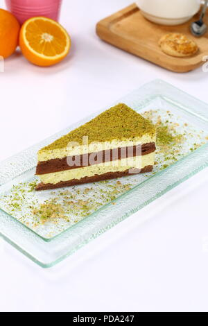 Three chocolate layered mousse cake - pistachio cheesecake - Stock Photo