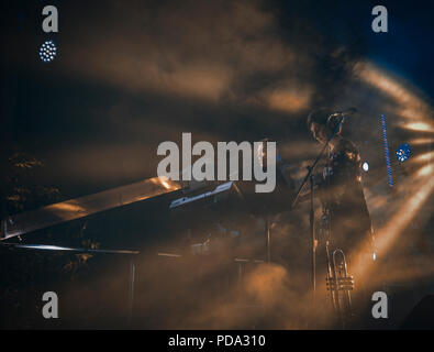 Band in yellow stage lights. - Stock Photo