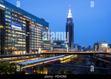 Japan, Honshu island, Kanto, Tokyo, the Shinjuku district and Dokomo tower. - Stock Photo