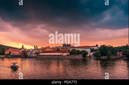 Stunning cityscape of Prague on a sunset in Czech Republic. Vltava river, Prazsky hrad (Prague castle). - Stock Photo