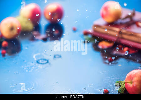 Autumn rain frame with copy space. Unfocused apples with water drops and place for text. Fresh and airy autumn harvest concept - Stock Photo