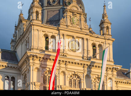 Facade of the Town Hall of Graz with a clock, the Austrian and Styrian flag on the Main Square of Graz, Austria - Stock Photo