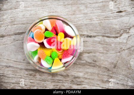 jelly in glass on wooden table background bowl Chopped close-up colorful Dessert - Stock Photo