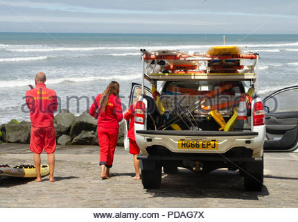 The RNLI (Royal National Lifeboat Institute) lifeguards are pictured on duty at a Westward Ho! Beach, The North Devon - Stock Photo