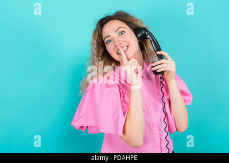 Woman in shirt with telephone - Stock Photo
