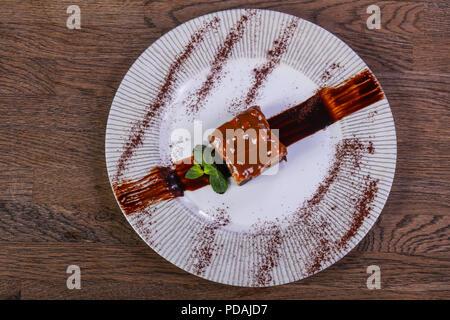Caramel brownie cake served caramel - Stock Photo