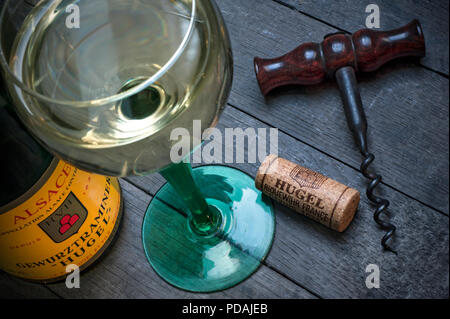ALSACE HUGEL Gewurztraminer white wine bottle glass and cork in wine cellar tasting situation by renowned producer 'Hugel'  Riquewihr Alsace France - Stock Photo