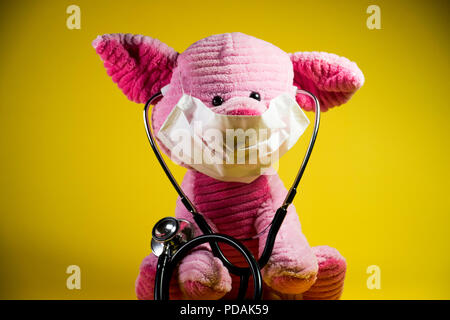 Swine flu concept. Plush toy with beady eyes and pig snout. - Stock Photo