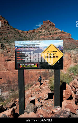 Sign warning hikers against the dangers of exhaustion, heat and injuries, Bright Angel trail, Grand Canyon National Park, USA. - Stock Photo
