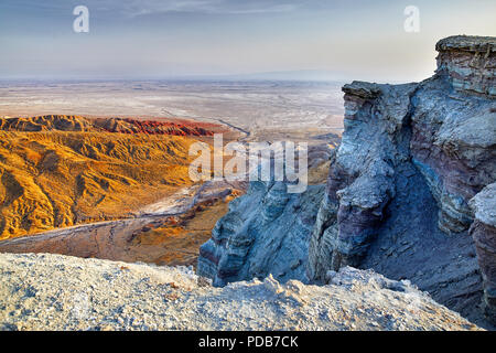 Aerial view of bizarre layered mountains in desert park Altyn Emel in Kazakhstan - Stock Photo