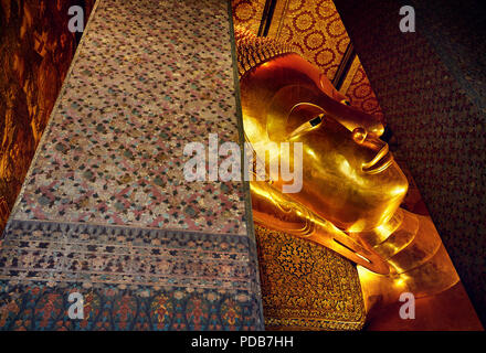 Famous Statue of Big Golden Buddha in wat Pho temple in Bangkok, Thailand. Symbol of Buddhist culture. - Stock Photo