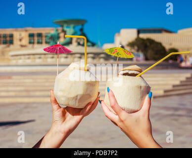 Two coconut drinks in Valletta, Malta - Stock Photo