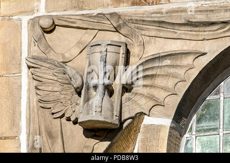 Leiden, The Netherlands, April 25, 2018: detail in the facade of Hooglandse Kerk showing an hourglass with wingsto symbolize the phrase 'time flies' - Stock Photo