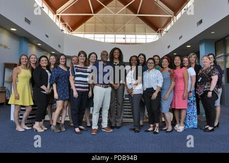 Tonya Wright, center, spouse of Chief Master Sgt. of the Air Force Kaleth O. Wright, poses for a photograph with Team Mildenhall key spouses at RAF Mildenhall, England, Aug. 2, 2018. During her visit, Mrs. Wright heard concerns and answered questions about U.S. Air Force family support programs. (U.S. Air Force photo by Senior Airman Christine Groening) - Stock Photo