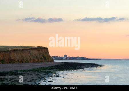 The view from Reculver towards Herne Bay at sunset. The Bishopstone Cliffs are seen on the left. - Stock Photo