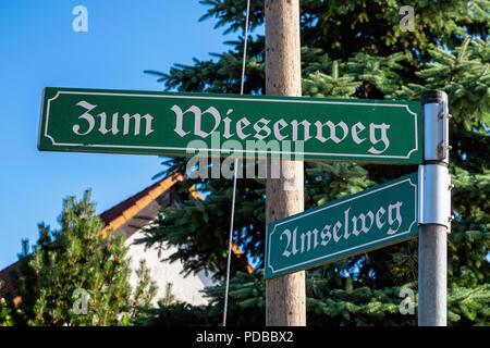 Germany, Stolpe an der Peene, green & white road sign on corner of Zum Wiesenweg and Umselweg - Stock Photo