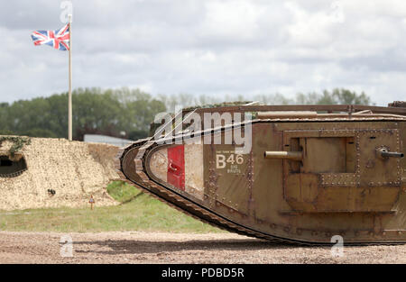 A replica World War One Mk4 tank takes part in a mock battle during an event at The Tank Museum in Bovington, Dorset, to mark the 100th anniversary of the Battle of Amiens, which saw more than 500 tanks spearhead an attack which ultimately led to the end of the First World War. - Stock Photo