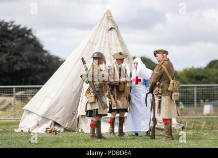 World War One living history actors during an event at The Tank Museum in Bovington, Dorset, to mark the 100th anniversary of the Battle of Amiens, which saw more than 500 tanks spearhead an attack which ultimately led to the end of the First World War. - Stock Photo