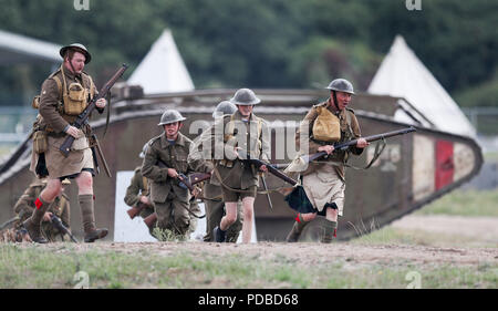 World War One living history actors take part in a mock battle during an event at The Tank Museum in Bovington, Dorset, to mark the 100th anniversary of the Battle of Amiens, which saw more than 500 tanks spearhead an attack which ultimately led to the end of the First World War. - Stock Photo