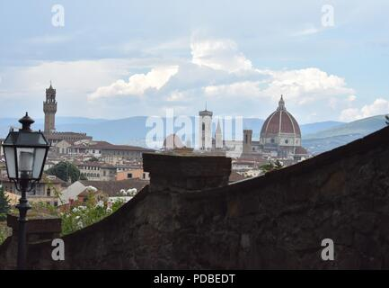 The Stunning Florence Skyline including the Duomo from an Aerial View with Blue Sky and Fluffly Clouds - Stock Photo