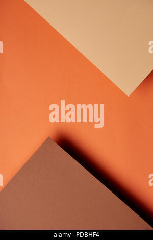 Paper sheets in brown and orange tones background - Stock Photo