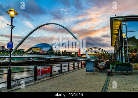 View of the Tyne River from outside Pitcher & Piano bar, looking towards the Millennium Bridge, Tyne Bridge and the Sage at sunset. Newcastle, UK. - Stock Photo