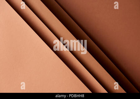 Pattern of overlapping paper sheets in brown tones - Stock Photo