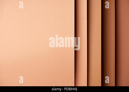 Paper sheets in brown tones background - Stock Photo