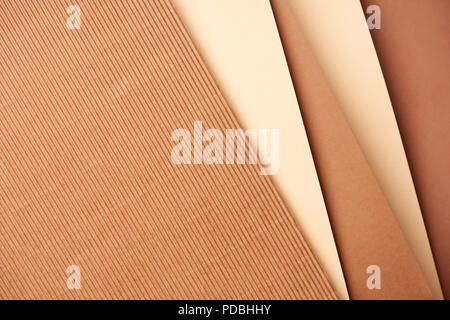 Pattern of diagonal paper sheets in beige and brown tones - Stock Photo