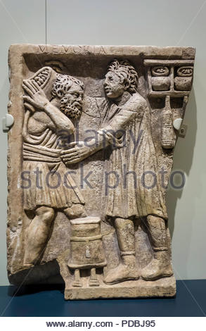 Roman tomb relief shop AD 200-300 labourer delivering goods to shopkeeper (r) at Royal Ontario Museum ROM in Toronto Ontario Canada - Stock Photo
