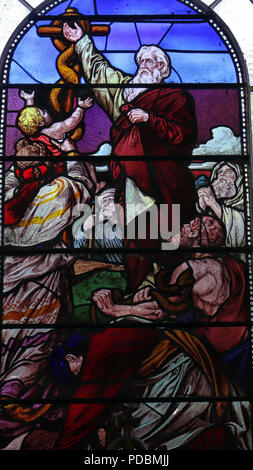 Victorian stained glass window depicting Moses lifting up the serpent in the wilderness. - Stock Photo