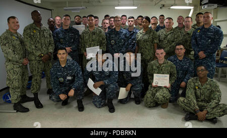 NEWPORT NEWS, Va. (Aug. 3, 2018) Sailors assigned to USS Gerald R. Ford (CVN 78) pose for a group photo after graduating from an in-port security force (ISF) class. (U.S. Navy photo by Mass Communication Specialist 2nd Class Cat Campbell) (This image has been altered by blurring out badges for security purposes) - Stock Photo
