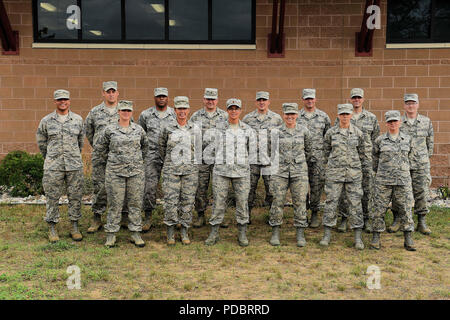ALPENA, Mich. —Members from the 127th Comptroller Flight and 127th Force Support Squadron, Selfridge Air National Guard Base, Mich., pose for a group picture after completing the 127thWing's operational readiness assessment at the Alpena Combat Readiness Training Center on Aug. 3, 2018. More than 500 Citizen-Airmen of the 127th Wing mobilized in a simulated deployment that created opportunities to practice their job proficiency while being assessed for wartime tasks. (U.S. Air Force photo by Master Sgt. David Kujawa) - Stock Photo