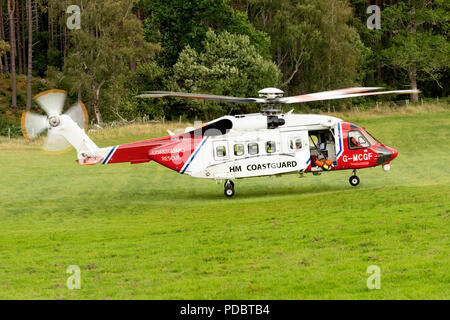 HM Coastguard Helicopter photographed west of Inverness. Sikorsky S-92 registration G-MCGF. - Stock Photo