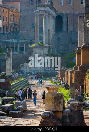 Rome, Italy.  The Roman Forum with the Temple of Saturn (Tempio di Saturno) in background. - Stock Photo