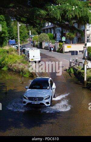 Car Fording the River Sid. East Devon, UK. August, 2018. - Stock Photo