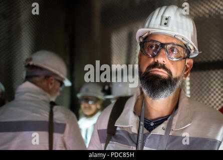 Salzgitter, Germany. 08th Aug, 2018. Olaf Lies (SPD), Minister of the Environment of Lower Saxony, is standing in the nuclear repository at Konrad shaft. A final nuclear storage facility is being built in the abandoned iron ore mine. Konrad is the only repository licensed under nuclear law. Credit: Julian Stratenschulte/dpa/Alamy Live News - Stock Photo