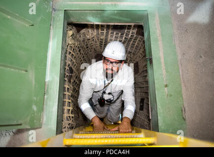 08 August 2018, Germany, Salzgitter: Olaf Lies of the Social Democratic Party (SPD), Minister of the Environment of Lower Saxony, climbs a ladder into shaft 2 in the Konrad shaft nuclear waste repository. Konrad is the only repository licensed under nuclear law. Photo: Julian Stratenschulte/dpa - Stock Photo