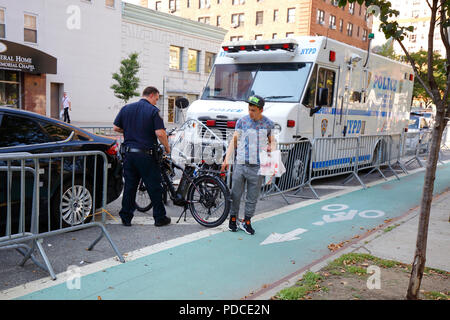 New York, NY, USA. 8th August, 2018.  Police examine a confiscated Class 2--throttle assist--electric bicycle, while a cyclist lingers briefly for a final parting touch. Electric bikes are currently illegal in New York State. NYC Mayor De Blasio has directed the Department of Transportation to begin allowing Class 1 pedal assisted electric bikes, while continuing the crackdown on all e bikes.  Most electric bike users are food delivery personnel.